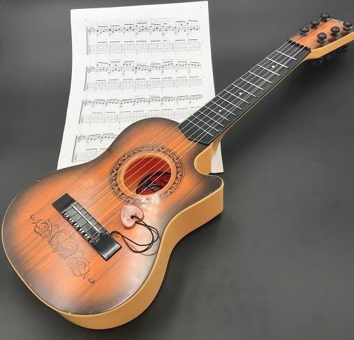 Xác định giá bán của đàn guitar cần mua