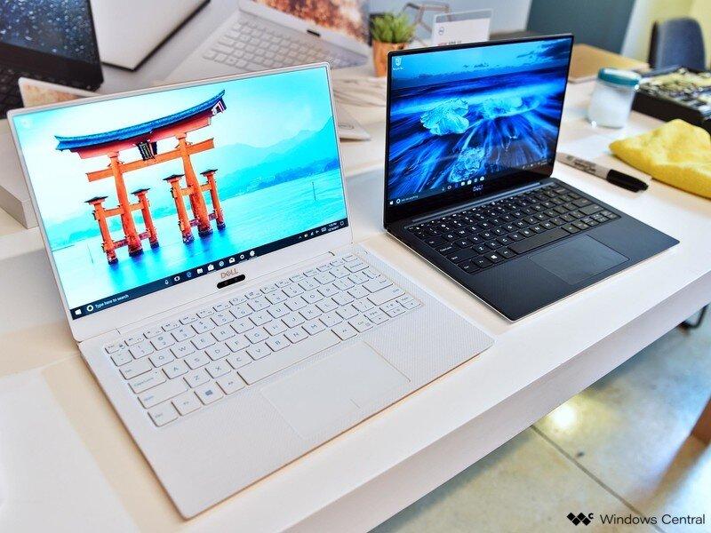 2 mẫu laptop Dell và Asus nằm cạnh nhau
