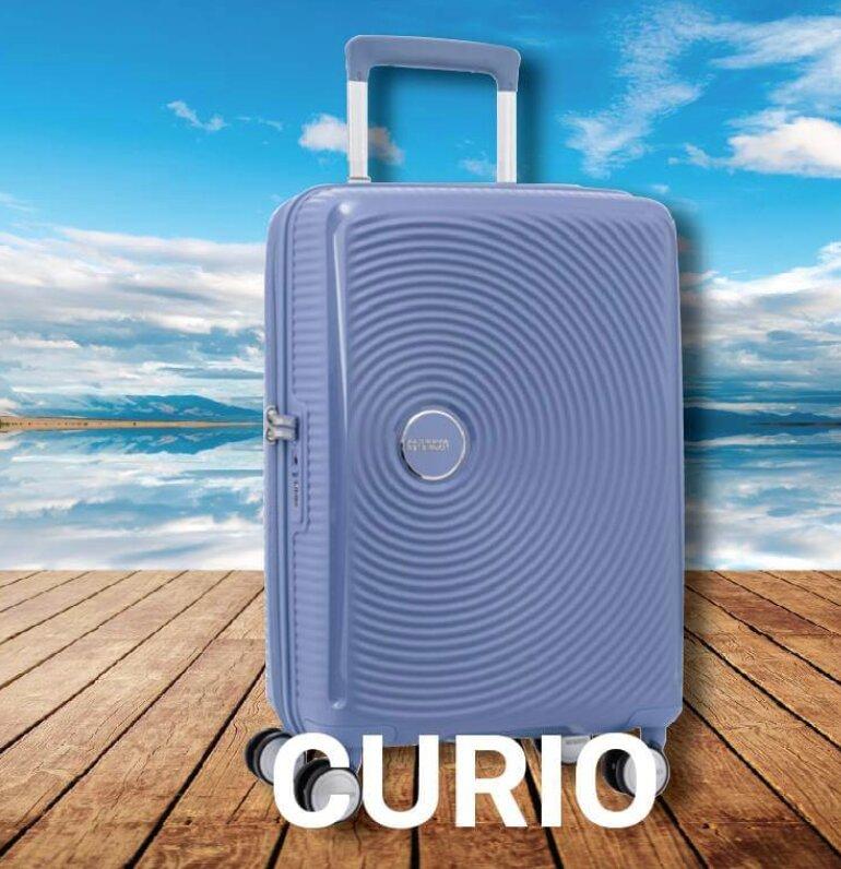 Vali American Tourister Curio có thiết kế đơn giản nhưng cực sang.