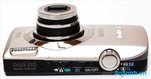 Cạnh đỉnh của máy ảnh du lịch Canon IXUS 210 là nơi tập trung toàn bộ các nút vật lý của máy