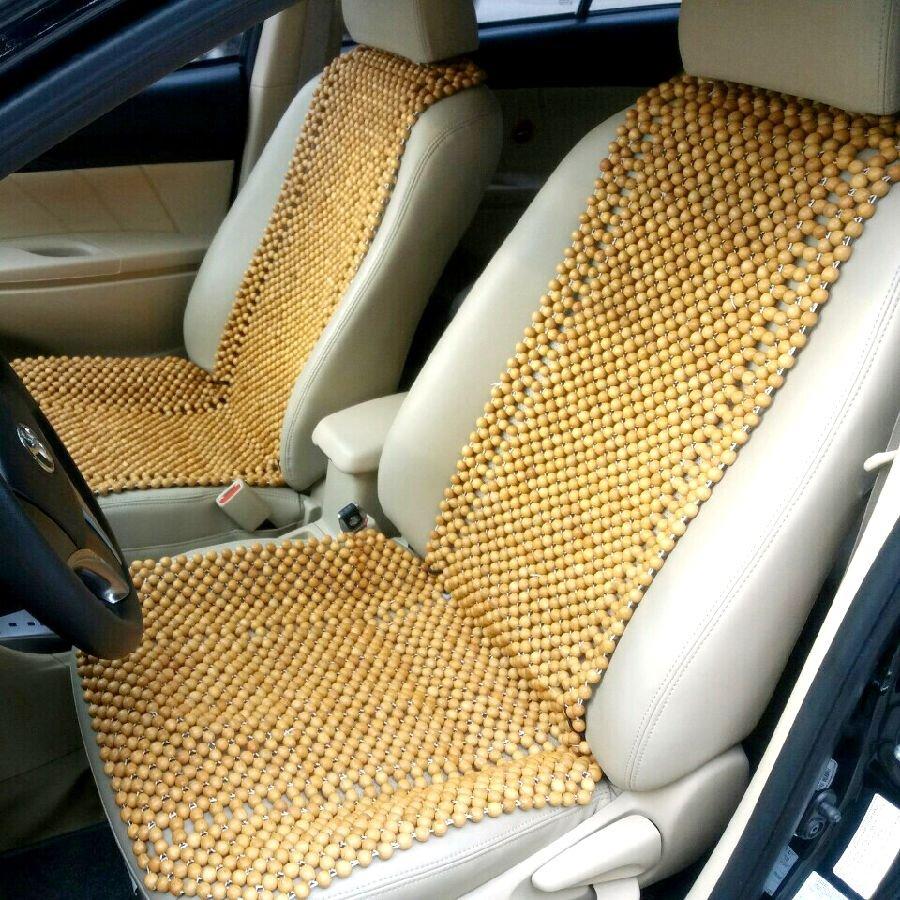 Miếng lót ghế xe bằng hạt gỗ giúp chống thoát vị đĩa đệm