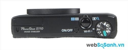Phần cạnh đỉnh của PowerShot S110 bố trí nút nguồn, nút chụp hình kết hợp vòng zoom, và vòng điều chỉnh chế độ chụp