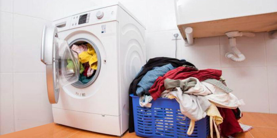 Giặt quần áo quá trọng lượng quy định gây hại máy giặt (Nguồn: Internet)