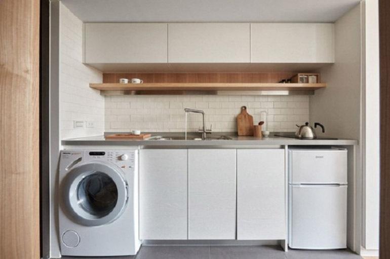 Máy giặt âm tủ bếp tiết kiệm diện tích cho gia đình bạn.