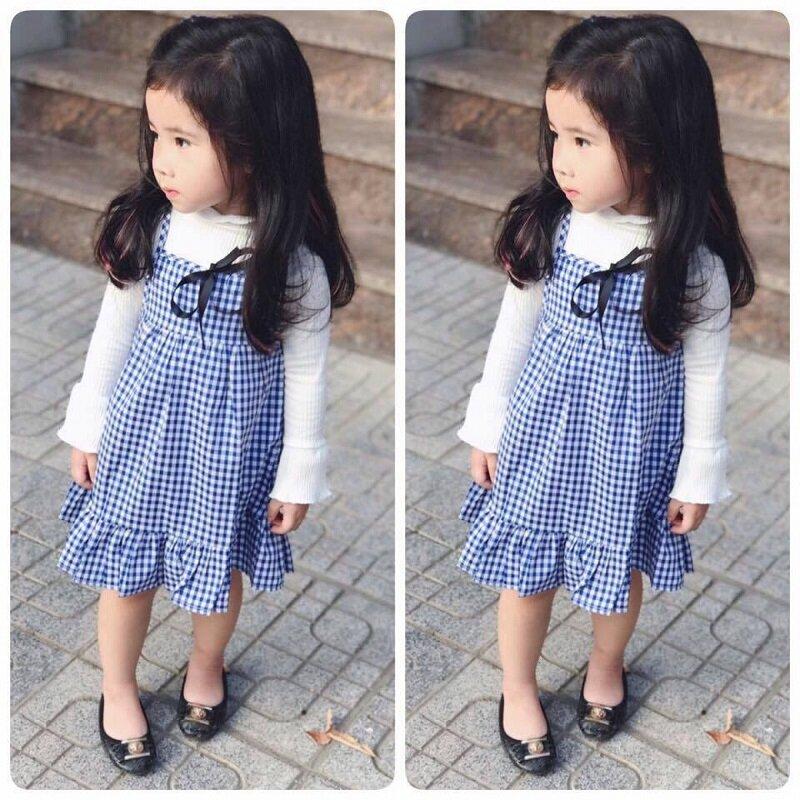Áo vest có thể kết hợp cùng chân váy hoặc quần kaki đều rất xinh mẹ nhé!