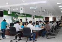 Làm sao để vay tiền mua nhà ở xã hội/thương mại ngân hàng Vietcombank?