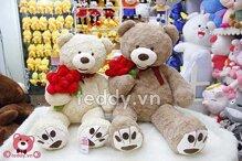 Tượng gấu Teddy ôm hoa